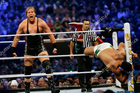 """Jacob """"Jake"""" Hager, Jr., Jose Alberto Rodríguez Jacob """"Jake"""" Hager, Jr., known as Jack Swagger, left, shouts after throwing Jose Alberto Rodríguez, of Mexico, known as Alberto Del Rio partially out of the ring as they wrestle, in East Rutherford, N.J., during the WWE Wrestlemania 29 event"""