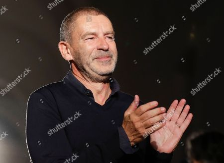 German fashion designer Tomas Maier acknowledges applause following the presentation of the Bottega Veneta women's Spring-Summer 2017 fashion show, that was presented in Milan, Italy