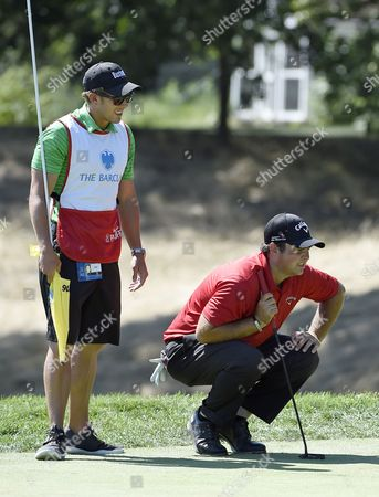 Patrick Reed, Kessler Karain, Barclays Golf Patrick Reed and his caddy, Kessler Karain study the green on the second hole during the final round of The Barclays golf tournament in Farmingdale, N.Y