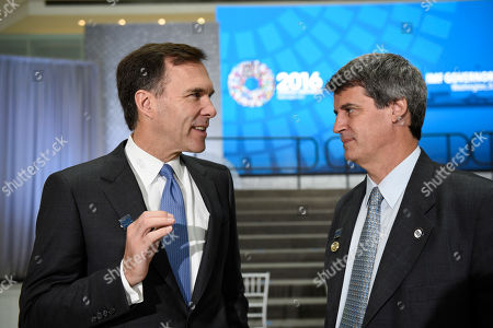 Morneau, Prat-Gaytake Canadian Minister of Finance Bill Morneau, left, talks with Argentina's Finance Minister Alfonso Prat-Gay after the International Monetary Fund governors family photo in Washington