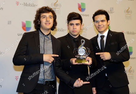 """3Ball MTY Mexican group 3Ball MTY show their Regional Mexican Album of the Year award at the Premio Lo Nuestro Latin Music Awards in Miami. 3Ball MTY will present """"Globall"""" in April 2014, the second album from the trio of Mexican DJs, with collaborations of America Sierra, Gerardo Ortiz, Belinda, Maria Barracuda and Far East Movement"""