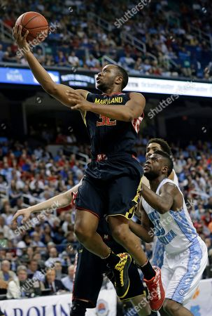 Dez Wells, Reggie Bullock Maryland's Dez Wells (32) drives past North Carolina's Reggie Bullock (35) during the second half of an NCAA college basketball game in the semifinals of the Atlantic Coast Conference tournament in Greensboro, N.C