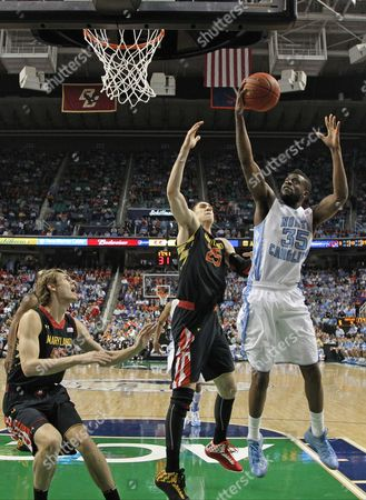 Reggie Bullock, Alex Len North Carolina's Reggie Bullock (35) shoots over Maryland's Alex Len (25) during the first half of an NCAA college basketball game in the semifinals of the Atlantic Coast Conference tournament in Greensboro, N.C