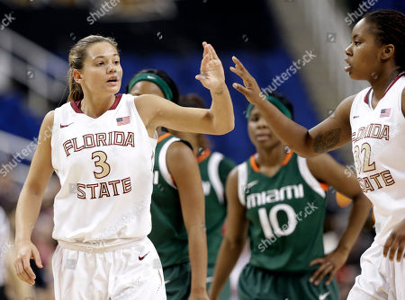 Alexa Deluzio, Lauren Coleman Florida State's Alexa Deluzio (3) is congratulated by teammate Lauren Coleman (32) during the second half of an NCAA college basketball game against Miami at the Atlantic Coast Conference tournament in Greensboro, N.C., . Florida State won 70-58