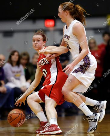 Alex Hall, Julie Forste Hartford guard Alex Hall, left, moves the ball against Albany forward Julie Forster during the first half of their NCAA college basketball game in the championship of the America East Conference tournament, in Albany, N.Y