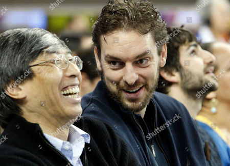 Pau Gasol, Patrick Soon-Shiong Los Angeles Lakers forward Pau Gasol, right, chats with Patrick Soon-Shiong, a minority owner of the Lakers, at an Arizona State-UCLA NCAA college basketball game in Los Angeles
