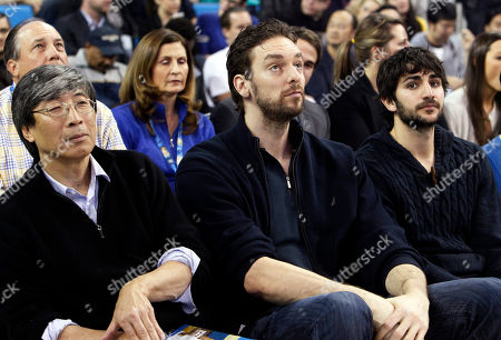 Patrick Soon-Shiong, Pau Gasol, Ricky Rubio Patrick Soon-Shiong, a minority owner of the Lakers, left, is joined by Lakers forward Pau Gasol, center, and Ricky Rubio, a point guard with the Minnesota Timberwolves, at the Arizona State-UCLA NCAA college basketball game in Los Angeles . Gasol and Rubio are both from Spain, and both played on the Spanish Olympic basketball team. The Timberwolves play the Lakers Thursday in Los Angeles