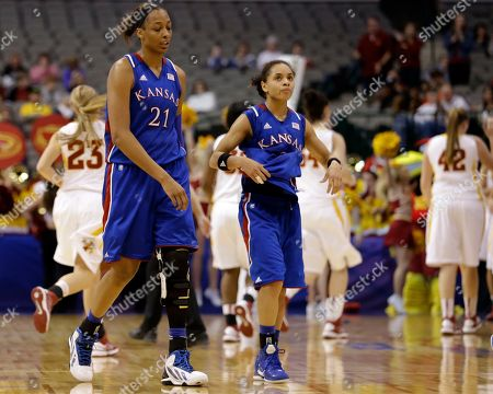 Carolyn Davis, Angel Goodrich Kansas' Carolyn Davis (21) and Angel Goodrich (3) walk back to the bench at the end of an NCAA college basketball game against Iowa State in the Big 12 women's tournament, in Dallas. Iowa State won 77-62