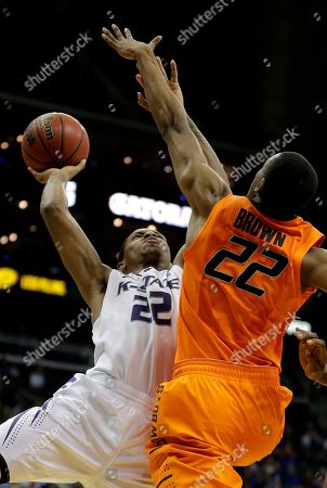 Rodney McGruder Kansas State guard Rodney McGruder, left, puts up a shot under pressure from Oklahoma State guard Markel Brown during the second half of an NCAA college basketball game in the Big 12 men's tournament, in Kansas City, Mo. Kansas State won the game 68-57