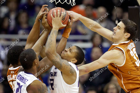 Rodney McGruder, Jonathan Holmes, Ioannis Papapetrou Kansas State guard Rodney McGruder (22) battles for a rebound with Texas forwards Jonathan Holmes (10) and Ioannis Papapetrou (33) during the first half of an NCAA college basketball game in the Big 12 tournament, in Kansas City, Mo. Kansas State forward Jordan Henriquez (21) gets in on the play