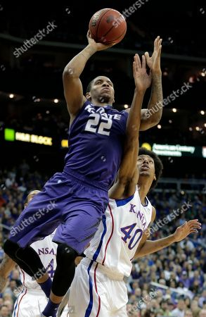 Rodney McGruder Kansas State guard Rodney McGruder (22) gets past Kansas forward Kevin Young (40) to put up a shot during the first half of the championship NCAA college basketball game of the Big 12 men's tournament, in Kansas City, Mo