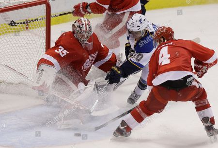 Andy McDonald, Jimmy Howard Detroit Red Wings goalie Jimmy Howard (35) deflects a shot by St. Louis Blues center Andy McDonald (10) during the third period of an NHL hockey game in Detroit