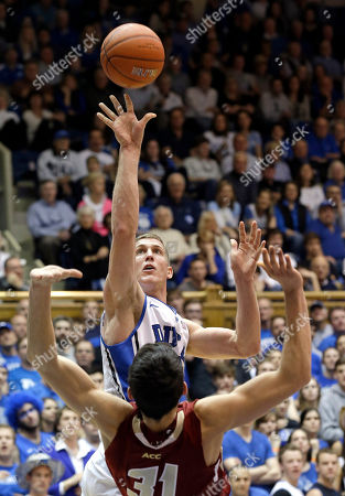 Mason Plumlee, Danny Rubin Duke's Mason Plumlee shoots as Boston College's Danny Rubin (31) defends during the second half of an NCAA college basketball game in Durham, N.C., . Duke won 89-68
