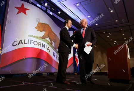 "Tom Del Baccaro, Karl Rove Republican strategist Karl Rove, right, shakes hands with California Republican Party Chairman Tom Del Beccaro, after giving a luncheon speech at the California Republican Party convention, in Sacramento, Calif., . Rove told California Republicans to ""get off the mat"", and to find candidates to reflect the party's diversity"