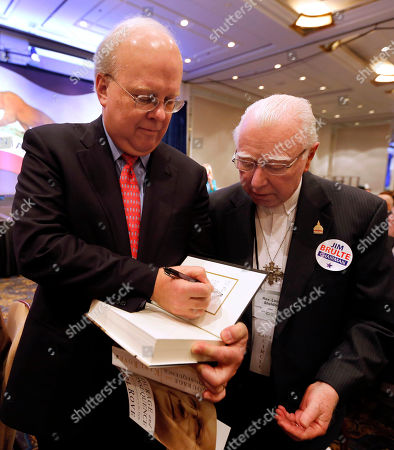 "Karl Rove Republican strategist Karl Rove autographs a copy of his book, "" Courage and Consequence"" for Rev. Lou Sheldon, at the California Republican Party convention, in Sacramento, Calif., . Rove spoke before a luncheon gathering and told California Republicans to ""get off the mat"", and find candidates to reflect the party's diversity"