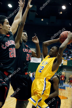 Stock Image of Jose Contreras, Terrel Payton, Amanda Elzy Corinth's Jose Contreras (20) and Terrel Payton (24) stop Amanda Elzy's Reginald Wright (12) during the fourth quarter of the Mississippi boy's Class 4A championship basketball game in Jackson, Miss., . Amanda Elzy won 59-41