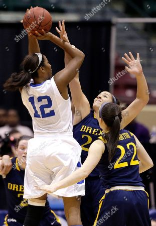 Stock Picture of Taylor Wootton, Meghan Creighton Drexel forward Taylor Wootton, back center, and guard Meghan Creighton (22) attempt to block a shot by Delaware forward Danielle Parker during the second half of an NCAA college basketball game in the championship of the Colonial Athletic Association conference tournament in Upper Marlboro, Md., . Delaware won 59-56