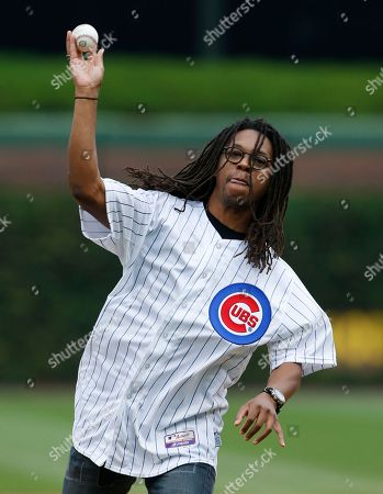 Lupe Fiasco Musician & Chicago Native Lupe Fiasco throws out a ceremonial first pitch before a baseball game between the St. Louis Cardinals and the Chicago Cubs, in Chicago