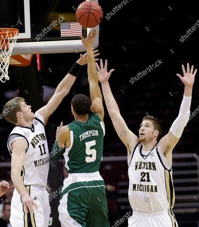 Nate Hutcheson, Shayne Whittington, Derek Thompson Western Michigan's Nate Hutcheson (11) and Shayne Whittington (21) pressure Eastern Michigan's Derek Thompson (5) in the first half of an NCAA college basketball game at the Mid-American Conference tournament, in Cleveland. Western Michigan won 70-55