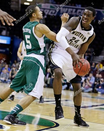 Derek Thompson, Darius Paul Eastern Michigan's Derek Thompson (5) pressures Western Michigan's Darius Paul (24) in the second half of an NCAA college basketball game at the Mid-American Conference tournament, in Cleveland. Western Michigan won 70-55