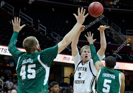 Connar Tava, Matt Balkema, Derek thompson Western Michigan's Connar Tava (2) passes the ball in front of Eastern Michigan's Matt Balkema (45) and Derek Thompson (5) in the first half during an NCAA college basketball game at the Mid-American Conference men's tournament, in Cleveland. Western Michigan won 70-55
