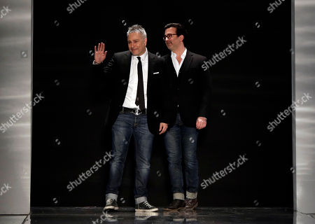 Ken Kaufman, Isaac Franco Designers Ken Kaufman, left, and Isaac Franco acknowledge audience applause after their Fall 2103 collection was modeled during Fashion Week in New York