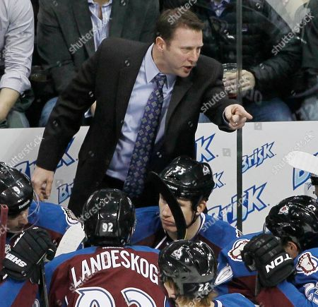 Joe Sacco Colorado Avalanche coach Joe Sacco, back, yells at his players after the Avalanche gave up two goals to the Calgary Flames early in the first period of an NHL hockey game in Denver on