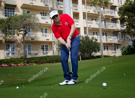 Tim Love Chef Tim Love putts on a Miami Beach, Fla. golf course during a tournament . Nearly a dozen A-list chefs took to the links early Saturday during the South Beach Wine and Food Festival for a battle of the chefs during a golf tournament
