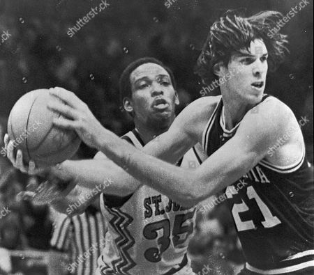 """Pennsylvania's Matthew White (21), right, grabs the ball in front of St. John's Reggie Carter (35) during the first half of an NCAA college basketball East Regional final in Greensboro, N.C. Matthew White was found stabbed in the neck around 12:45 p.m. in bed at his home in Philadelphia, police said, and was pronounced dead a short time later. An officer responding to the home for a report of a stabbing found White's wife, Maria Rey Garcia-Pellon, as she pulled into the driveway, authorities said. As she was being taken into custody, according to a police affidavit, she said, """"I caught him looking at pornography, young girls. I love kids. I had to do it"""