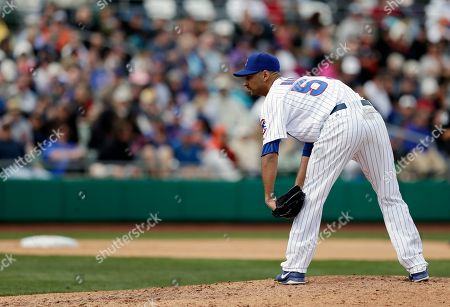 Cory Wade Chicago Cubs' Cory Wade throws during an exhibition spring training baseball game against the San Francisco Giants, in Mesa, Ariz