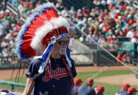 "Stock Image of Cleveland Indians fan Jon Brittain, aka ""Chief Yahoo"", from Lakewood, Ohio, watches his team take on the Cincinnati Reds in an exhibition spring training baseball game, in Goodyear, Ariz"