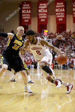 Christian Watford, Aaron White Indiana forward Christian Watford, right, drives on Iowa forward Aaron White in the second half of an NCAA college basketball game in Bloomington, Ind., . Indiana defeated Iowa 73-60