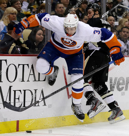 Beau Bennett, Travis Hamonic New York Islanders defenseman Travis Hamonic (3) is checked into the boards by Pittsburgh Penguins right wing Beau Bennett (19) during the second period of an NHL hockey game in Pittsburgh