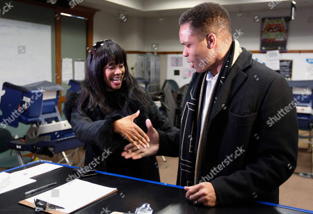 Stock Image of Jesse Jackson Jr., Sandi Jackson Rep. Jesse Jackson Jr., D-Ill., and his wife, Chicago Alderman Sandi Jackson, ask each other for their support and votes as they arrive at a polling station for early voting in Chicago. On, Jackson, who resigned last year after nearly 17 years in office, was charged with spending $750,000 in campaign funds on personal expenses. His wife, Sandi, who resigned from the City Council in January 2013, was charged with filing false income tax forms