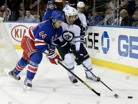 Evander Kane, Steve Eminger New York Rangers' Steve Eminger (44) and Winnipeg Jets' Evander Kane fight for control of the puck during the first period of an NHL hockey game, in New York