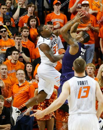 Marcus Smart, Rodney McGruder, Phil Forte Oklahoma State guard Marcus Smart (33) blocks a shot by Kansas State guard Rodney McGruder in the second half of an NCAA college basketball game in Stillwater, Okla., . Oklahoma State won 76-70. Oklahoma State guard Phil Forte (13) looks on