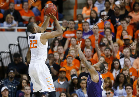 Markel Brown, Rodney McGruder Oklahoma State guard Markel Brown (22) shoots over Kansas State guard Rodney McGruder (22) in the second half of an NCAA college basketball game in Stillwater, Okla., . Oklahoma State won 76-70