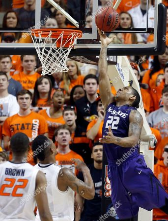 Rodney McGruder, Markel Brown, Le'Bryan Nash Kansas State guard Rodney McGruder shoots in front of Oklahoma State guard Markel Brown (22) and guard Le'Bryan Nash (2) in the first half of an NCAA college basketball game in Stillwater, Okla., . Oklahoma State won 76-70