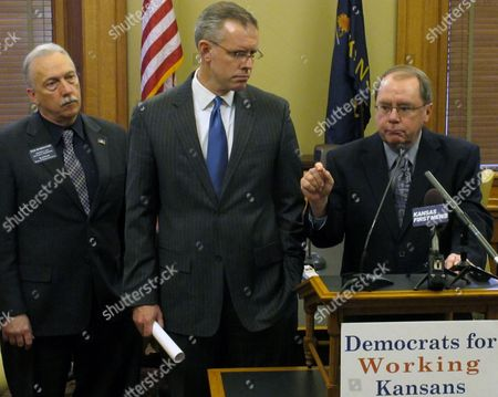 Kansas Senate Minority Leader Anthony Hensley, right, a Topeka Democrat, makes a point during a news conference on labor issues, at the Statehouse in Topeka, Kan. Watching Hensley are, House Minority Leader Paul Davis, center, a Lawrence Democrat, and Rep. Tom Burroughs, left, a Kansas City Democrat