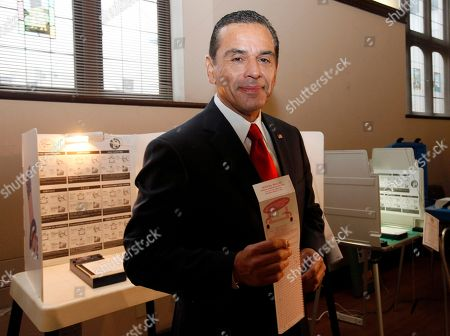 Antonio Villaraigosa Los Angeles Mayor Antonio Villaraigosa smiles at media after voting in Los Angeles. Los Angeles voters are going to the polls to choose a new mayor. Polls show a tight contest between Councilman Eric Garcetti and City Controller Wendy Greuel in the race to replace term-limited Mayor Antonio Villaraigosa. An expected low turnout makes surprises more likely, boosting the chances of Democratic Councilwoman Jan Perry and Republican Kevin James, a former prosecutor and radio talk show host. If no one gets more than 50 percent of the vote, then the top two candidates will face each other in a May runoff