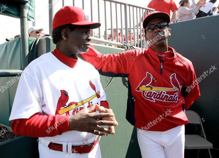 Lou Brock, Willie McGee Former MLB baseball players Lou Brock, left, and Willie McGee talk during the fifth inning of an exhibition spring training baseball game between the St. Louis Cardinals and the Miami Marlins, in Jupiter, Fla