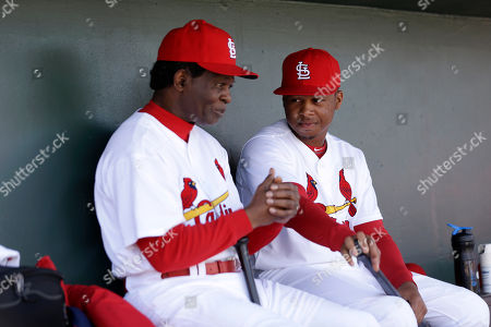 Adron Chambers, Lou Brock Former MLB baseball player Lou Brock, left, talks to St. Louis Cardinals center fielder Adron Chambers during the fourth inning of an exhibition spring training baseball game against the Miami Marlins, in Jupiter, Fla