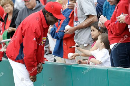 Lou Brock Former MLB baseball player Lou Brock, left, talks to children while signing autographs before an exhibition spring training baseball game between the St. Louis Cardinals and the Miami Marlins, in Jupiter, Fla