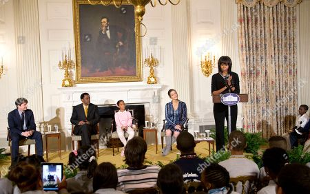 Michelle Obama, Benh Zeitlin, Dwight Henry, Quvenzhané Wallis, Rachel Goslins First lady Michelle Obama speaks in the State Dining Room of the White House in Washington, during a celebration of the Black History Month, welcoming middle and high school students from the District of Columbia area and New Orleans taking part in an interactive student workshop with the cast and crew of the film Beasts of the Southern. From left are, Benh Zeitlin, Dwight Henry, Quvenzhané Wallis and Rachel Goslins