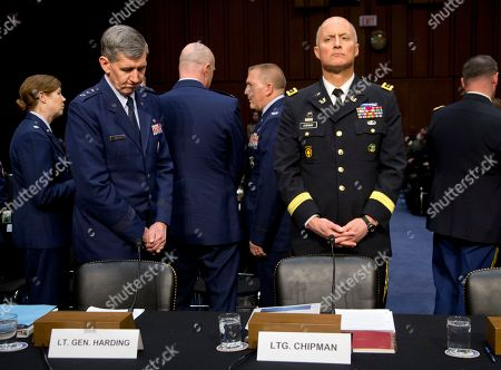Richard Harding, Dana Chipman Lt. Gen. Richard Harding, Judge Advocate General of the United States Air Force, left, and Lt. Gen. Dana Chipman, Judge Advocate General of the United States Army, wait testify on Capitol Hill in Washington, before the Senate subcommittee on Personnel hearing on sexual assault in the military