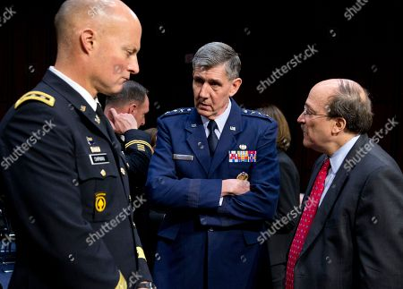 Stock Photo of Robert taylor, Dana Chipman, Richard Harding From left, Lt. Gen. Dana Chipman, Judge Advocate General of the United States Army; Lt. Gen. Richard Harding, Judge Advocate General of the United States Air Force, and Robert Taylor, acting General Counsel of the Defense Department, talk on Capitol Hill in Washington, prior to testifying before the Senate subcommittee on Personnel hearing on sexual assault in the military