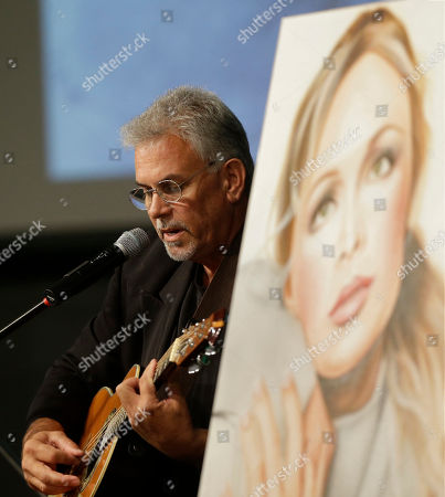 Michael Inge, stepfather of country music star Mindy McCready, plays a song during the funeral ceremony at the Crossroads Baptist Church in Fort Myers, Fla., . McCready committed suicide Feb. 17 at her home in Arkansas, days after leaving a court-ordered substance abuse program