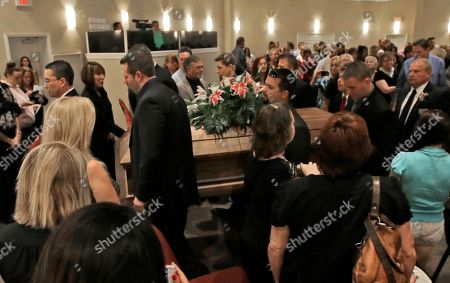 Pall bearers carry the casket of country music star Mindy McCready after a funeral ceremony at the Crossroads Baptist Church in Fort Myers, Fla., . McCready committed suicide Feb. 17 at her home in Arkansas, days after leaving a court-ordered substance abuse program