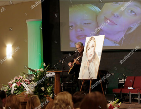 Michael Inge, stepfather of country music star Mindy McCready, plays a song during the funeral ceremony at the Crossroads Baptist Church in Fort Myers, Fla.,. McCready committed suicide Beb. 17 at her home in Arkansas, days after leaving a court-ordered substance abuse program