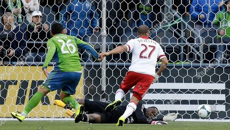 Donovan Ricketts Portland Timbers goalkeeper Donovan Ricketts lies on the pitch after deflecting the ball as Timbers' Mikael Silvestre (27) and Seattle Sounders' Sammy Ochoa (26) close in during the first half of an MLS soccer match, in Seattle. The Sounders and the Timbers played to a 1-1 draw